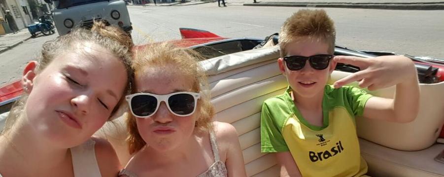 Cuba kids in auto
